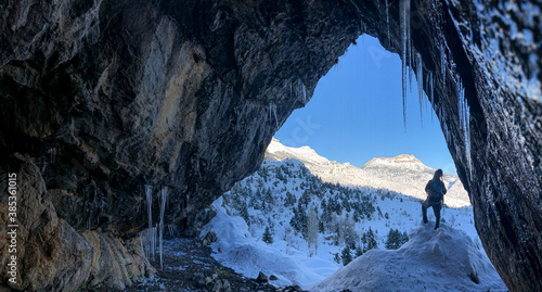 Obraz Curious looks from a beautiful cave on a cold winter day - fototapety do salonu