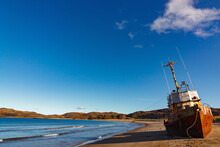 A Wrecked Ship On A Sandy Beac...