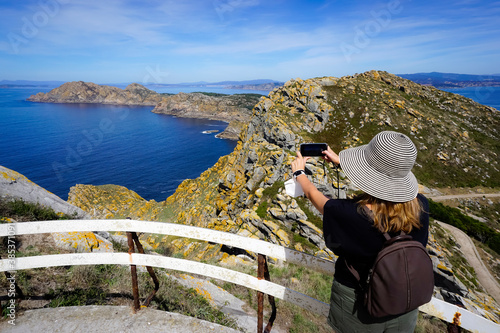 Woman taking photos in the Cies Islands