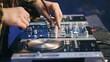 Man's hands playing music on dj mixer. Closeup. Party concept.