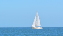 Small White Sloop Rigged Yacht...