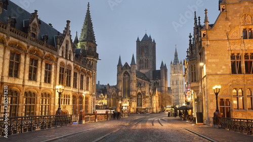 Fotomural Illuminated street near St Michael bridge and St Bavo's Cathedral in a historical center of Ghent city