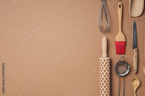 Fotografia Set of modern cooking utensils on brown background, flat lay