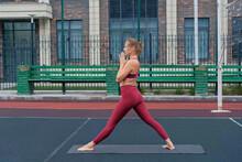 Woman Athlete Practices Yoga E...
