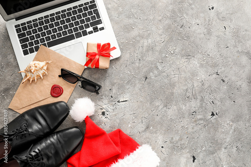 Fototapeta Composition with Santa hat, laptop and male accessories on grey background obraz