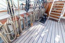 Tall Ship Rope, Wires Tightly Packed Along The Ship Ready To Lift Up To Free The Wings