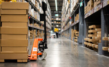 Cartons On Pallet Trucks In Th...