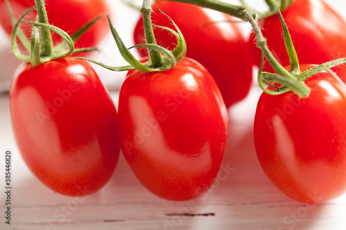 Cherry tomato on white table