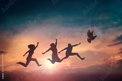 Fotografie, Tablou Happy family people group celebrate jump for good life on weekend concept for win victory, person faith in financial freedom healthy wellness, Great insurance team support retreat together in summer