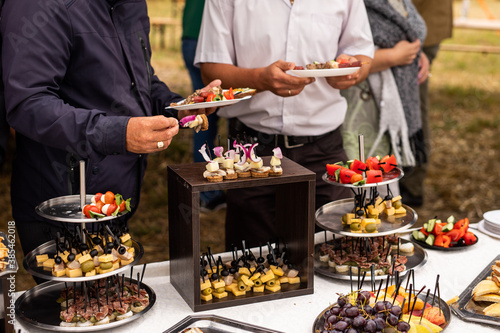 Fotografie, Obraz A set of canapes and snack at a banquet with white table