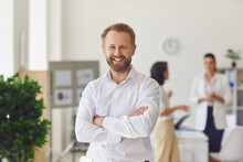 Happy Successful Businessman Or Company Employee Standing In Office Looking At Camera