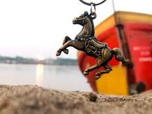 Horse At Riverbank