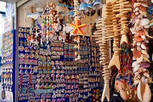 Bodrum, Turkey - August, 2020: Atmospheric Local Souvenir Markets. Turkish Grand Bazaar. Hand-made Souvenirs At Street Market. Souvenirs: Wind Music, Dream Catcher, Evil Eye Keychain, Beads, Bracelets