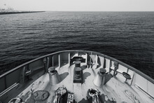 Bow Of A Tug Boat And Seawater. Blue Toned Photo