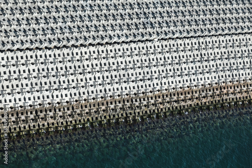 Photo Breakwater made of concrete blocks. Background