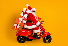 Profile Side View Of His He Nice Funny Cheery Amazed St Nicholas Riding Moped Hurry Up Delivering Pile Stack Giftboxes December Winter Isolated Bright Vivid Shine Vibrant Yellow Color Background