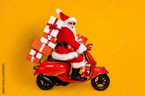 Fotomural Profile side view of his he nice funny cheery amazed St Nicholas riding moped hu