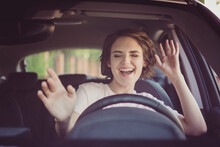Photo Of Positive Cheerful Girl Funky Driver Rider Enjoy Drive Ride Car Under Pop Star Hits Playlist Music Try Dance Raise Hands In City Center