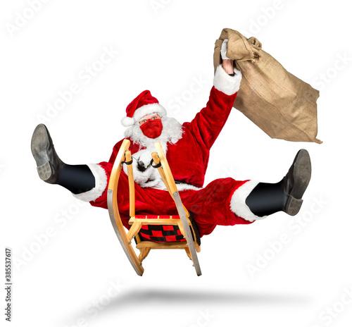 Leinwand Poster crazy santa claus with covid-19 coronavirus face breathing mask on his sleigh bi