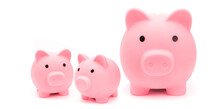 Money Box Piggy Bank Family On White Background As Financial Saving Concept