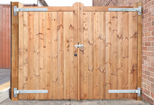 Double Wooden Gates With Metal Latch And Hinges