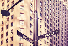 Wall Street And Broadway Street Sign In Manhattan, Color Toning Applied, Selective Focus, New York, USA.