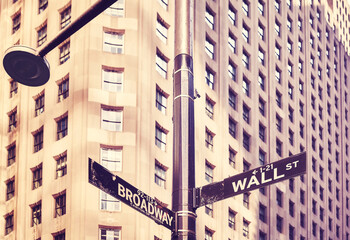Panel Szklany Podświetlane Architektura Wall Street and Broadway street sign in Manhattan, color toning applied, selective focus, New York, USA.