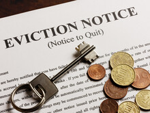 Eviction Note Coins And Apartment Key