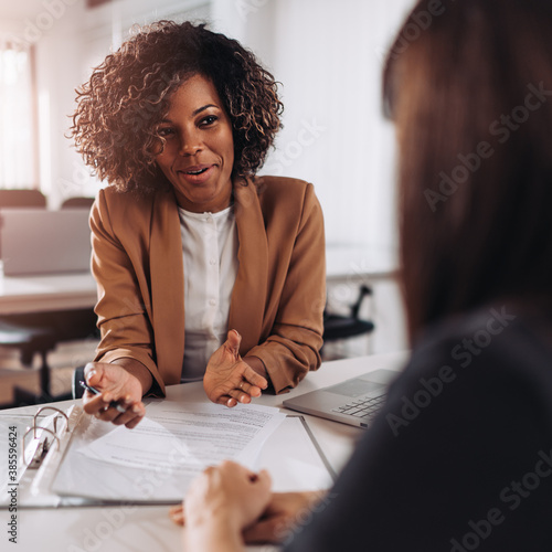 Woman consulting with a female agent