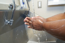 Black Healthcare Worker Washing Hands