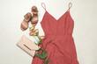 Leinwandbild Motiv Flat lay composition with stylish coral dress on light stone background
