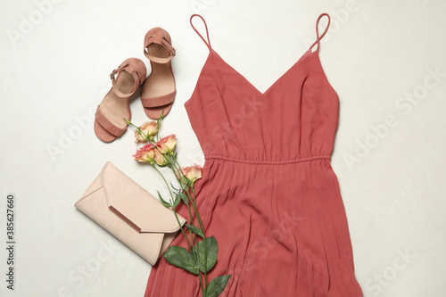 Obraz Flat lay composition with stylish coral dress on light stone background - fototapety do salonu