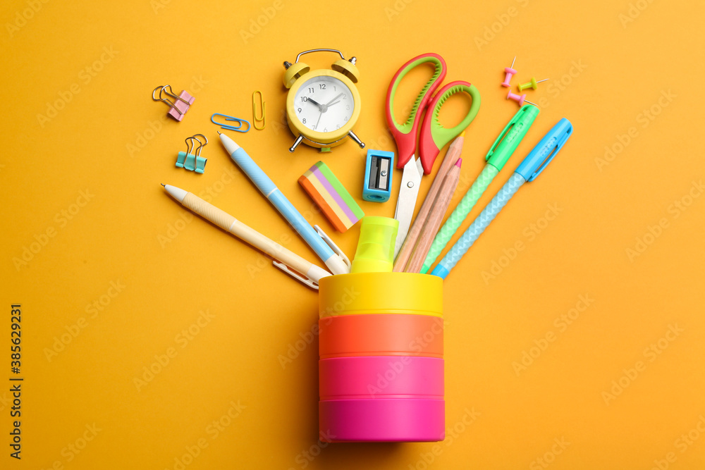 Fototapeta Flat lay composition with school stationery on orange background. Back to school
