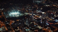 Smooth Aerial Zoom Out Over Downtown Nashville At Night Showing Nissan Stadium, Interstate 24, And Korean Veterans Boulevard