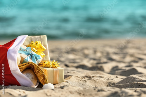 Santa Claus bag with gifts on beach Canvas