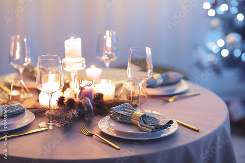 Valokuva Beautiful table setting with Christmas decor in living room