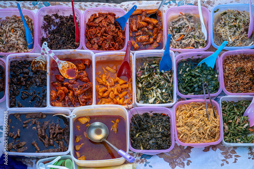 Cuadros en Lienzo Variety of delicious Malaysian home cooked dishes sold at street market stall in