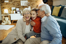Cheerful Grandparents And Granddaughter Having Fun Together At Home.