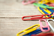 Colorful Paperclips On Old Woo...