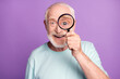 canvas print picture - Close-up portrait of cheerful grey beard hair pensioner investigator watching through loup isolated over purple background