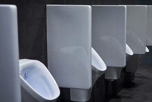 Row Of Urinals In A Public Res...
