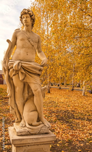 Garden plaster statue depicting  allegorical figure of  hunter in  autumn park Canvas Print