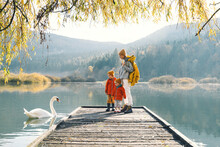 Family In Nature Background. W...
