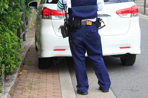 Fotografía 警察官による駐車違反の取り締まり