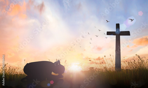 Good Friday concept: Silhouette of prayer woman bow down and praying over cross Poster Mural XXL