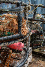 Stack Of Rustic Lobster And Crab Pots On A Dock Located In Coastal Oregon