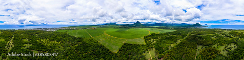 Mauritius, Black River, Flic-en-Flac, Helicopter panorama of green island landscape in summer