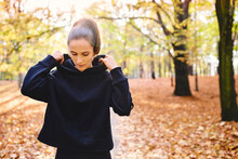 Young Female Jogger In Autumn ...