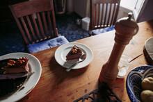 Slice Of Cake In Plate On Tabl...