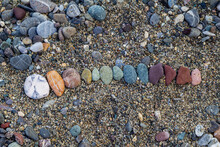 Close-up Of Pebbles On Land At...